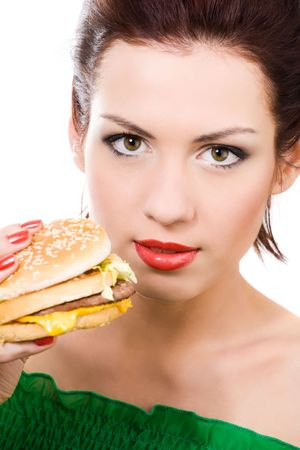 close-up portrait of young woman with hamburger photo
