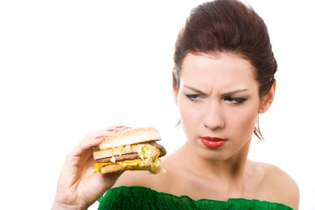 close-up portrait of young displeased woman with hamburger photo