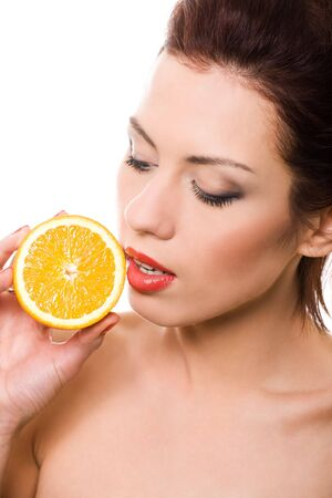 closeup portrait of girl with half of orange over white Stock Photo - 4769416