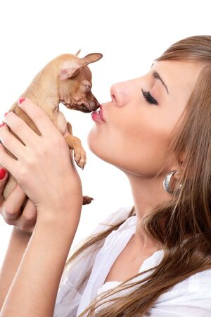 toy terrier puppy on hand of young woman isolated on white