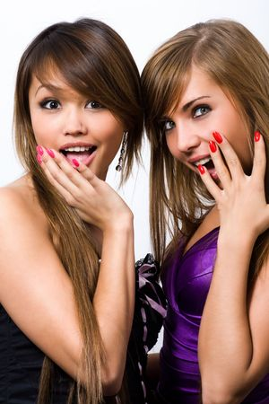 two young beautiful women are very surprised photo