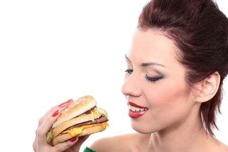 close-up portrait of young beautiful woman is eating big mac isolated on white Stock Photo - 4988304
