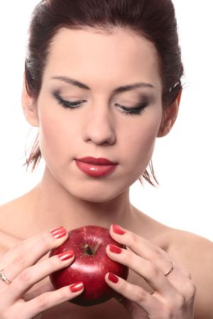 close-up portrait of young beautiful healthy woman with red apple isolated on white Stock Photo - 4988298