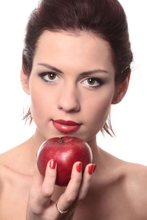 close-up portrait of young beautiful healthy woman with red apple isolated on white photo