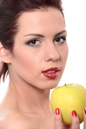 close-up portrait of young beautiful healthy woman with yellow apple isolated on white photo