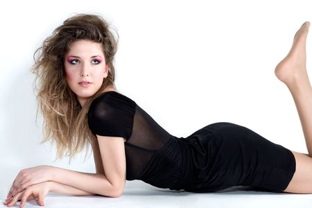 young sexy woman is lying in black dress photo