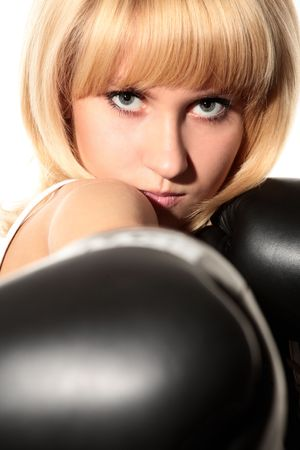 close-up portrait of girl with black boxing gloves photo