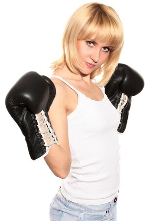 portrait of young sexy blond woman in black boxing gloves isolated on white photo
