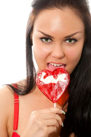 closeup portrait of young sexy brunette woman with lollipops isolated on white photo