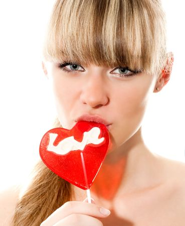 licking in isolated: Ritratto di giovane donna nuda sexy succhiare lollypop isolati su bianco Archivio Fotografico