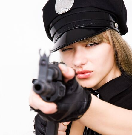 portrait of young sexy woman aim with black tommy gun photo