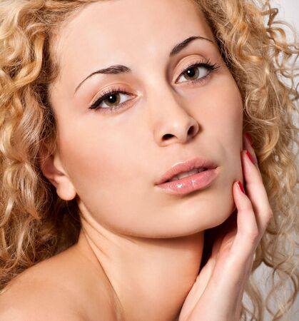 closeup portrait of young blond curly hair woman photo