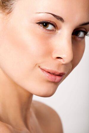 closeup facial portrait of young beautiful woman
