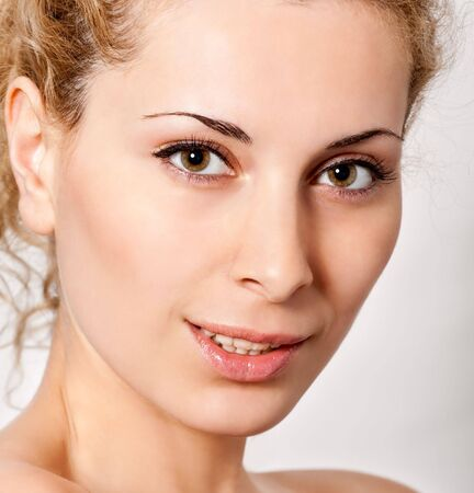 closeup portrait of young blond smiling woman Stock Photo - 5285507