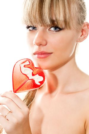 close-up portrait of young sexy blond woman with lollipop isolated on white photo