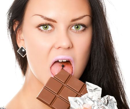 closeup portrait of young woman with bar of chocolate isolated on white photo