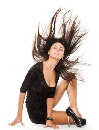 wind dress: portrait of young sexy brunette woman with stunning hairs isolated on white