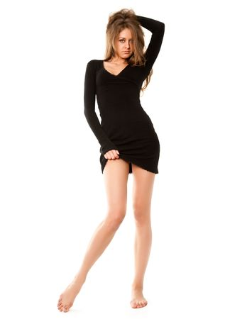 portrait of young sexy woman in black dress isolated on white photo