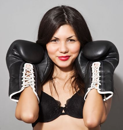 erotic portrait of young brown hair woman in black boxing gloves and lingerie Stock Photo - 5731947