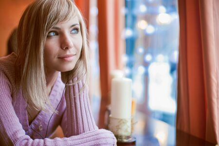 Young beautiful woman is sitting in cafe alone Stock Photo - 6339418
