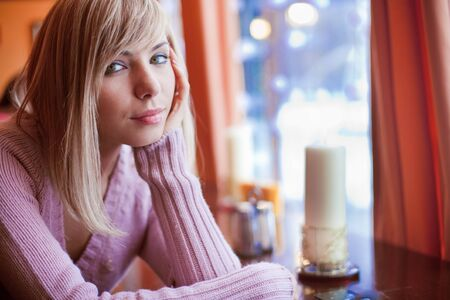Young beautiful woman is sitting in cafe alone Stock Photo - 6339421