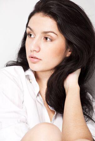closeup portrait of young brunette woman photo