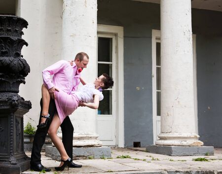 young loving man and woman is dancing in park Stock Photo - 7145045