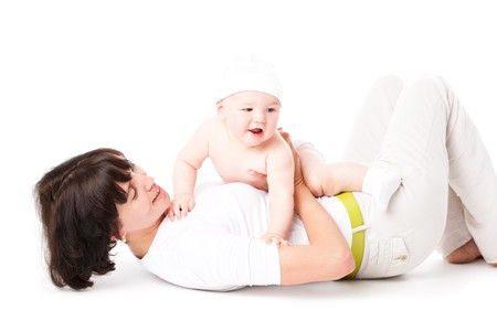 happy mother is playing with her 10 month baby over white  photo