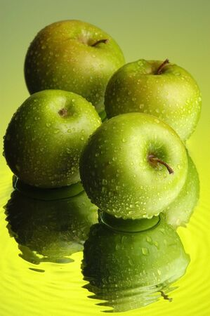 Green apple and water Stock Photo
