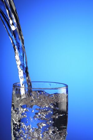 A jet of water into a glass
