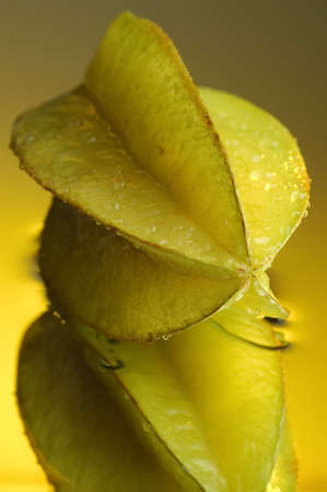 Carambola and water on a mirror Stock Photo