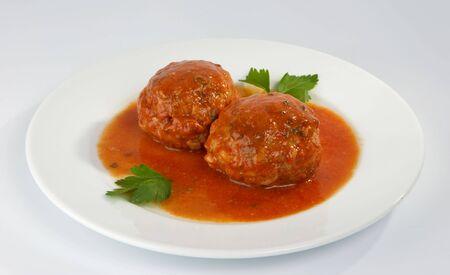 Meatballs with mushrooms in tomato sauce. Stock Photo