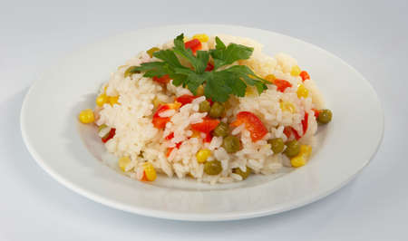Rice with a green peas, corn and sweet pepper.