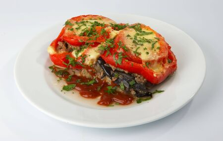 The fried tomatoes stuffed with meat, eggplants and cheese. Stock Photo