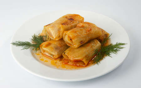 Meat stuffed cabbage leaves, stewed in tomato sauce.