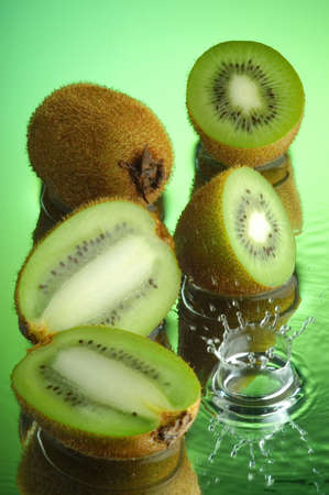 Kiwi and water on a mirror Stock Photo