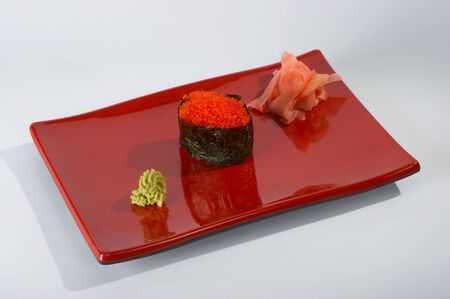 Sushi on the plate on the white background. Stock Photo