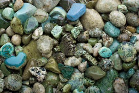 Background made of cold colors pebbles. Stock Photo