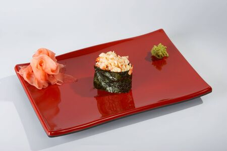 Sushi on the plate on the light background.