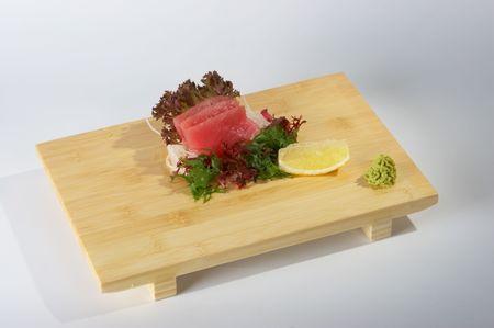 Sashimi on the tray on the light background.