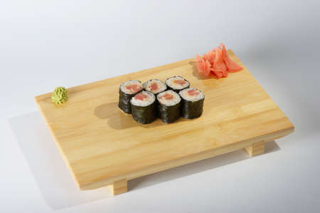 Rolls on the tray on light background.