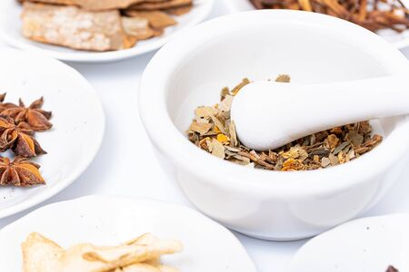 Chinese herb selection with mortar and pestle Banco de Imagens