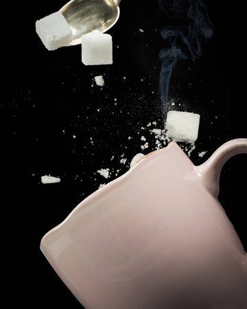 adversity: Sugar cubes misses the cup