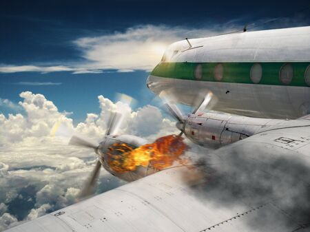 Airplane with burning engine Stock Photo