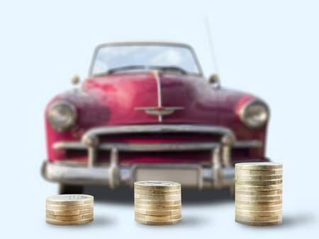 coin stacks in front of classic car