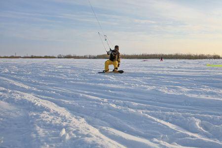 kiting: Winter sports. Ski kiting on a snowy river. Stock Photo