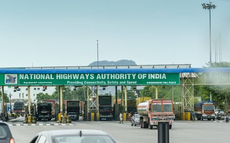 Krishnagiri, Tamil Nadu  India - 9th August 2019: Private and commercial vehicles waiting in line to pass through toll plaza in india, fast tag lanes, national highway authority of india Editöryel