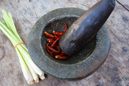 сooking: Pound pepper and lemon grass Stock Photo