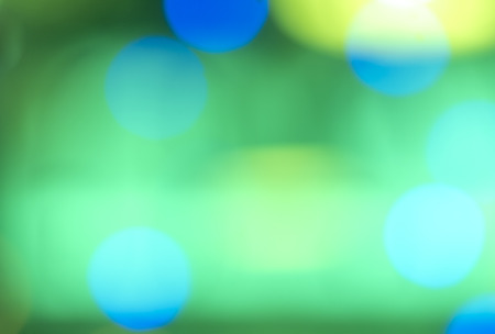 Soft colorful bokeh background. Luminous garlands of electric lights. Copy space to add text. Saturated colors. Blurry abstraction. Gentle tone. Dark night. Festive party in city. Defocus effect.