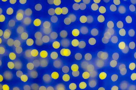 fill in: Celebration in the city. Luminous garlands. Soft, colorful bokeh different colors. Fill the entire background. Tender tones brown, blue, yellow, pink.